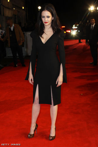 Eva Green an AW11 black split sleeve dress and Pre AW11 leopard print peep toe shoes by Alexander McQueen to the 'The Rum Diary' London