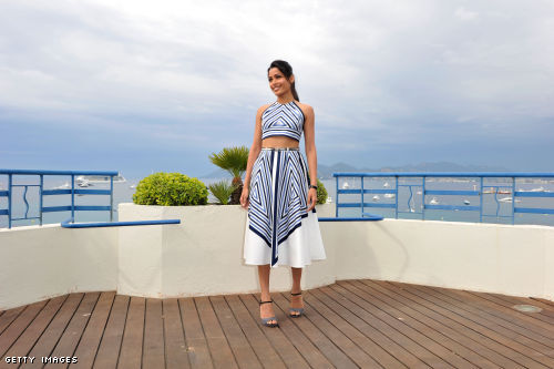 Frieda Pinto wearing a Salvatore Ferragamo midrif baring 2-piece outfit at the Cannes Film Festival