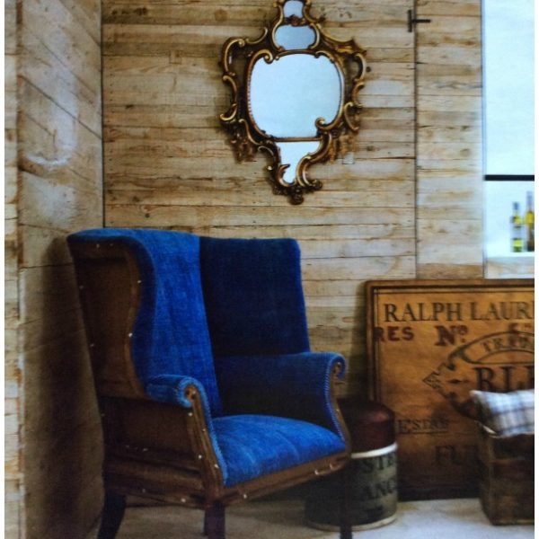 This chair was only the bones when I found it at the Brimfield Flea Market, I left the back exposed and used a deep blue Chanel Velvet. The mirror was found in my mother attic. The vintage sign came from the 25th street Flea Market in New York City
