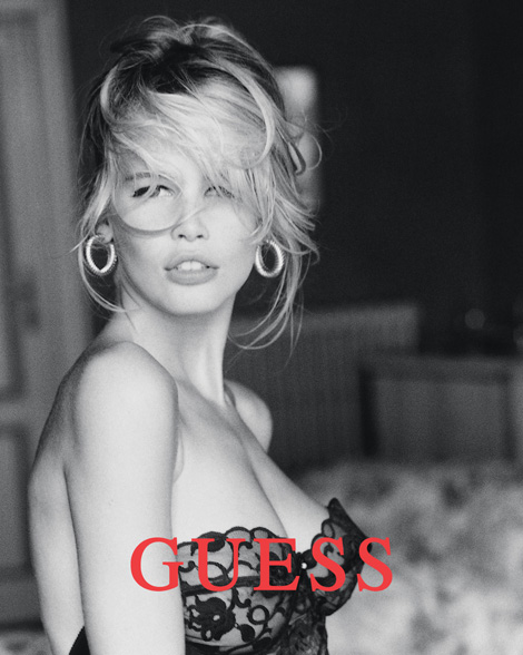 Claudia Schiffer in her iconic bustier shot from the Guess 1989 campaign