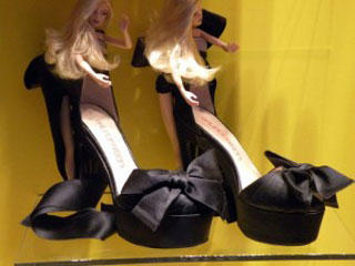 Barbie dolls dress shoes in the windows of Colette Paris