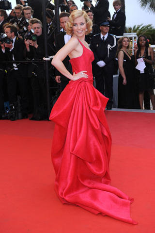 Elizabeth Banks in Armani PrivA© single shoulder coral colour silk evening gown in tone on tone jacquard organza with side drape motif.
