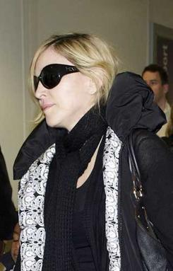 Madonna glams up a natural look with some MDG Collection sunglasses