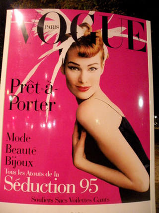 A History of French Vogue Magazine Covers Line the Champs Elysees