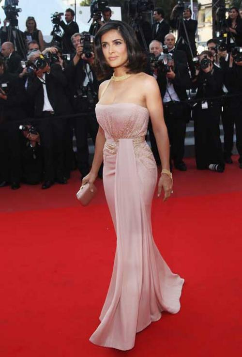 Salma Hayek wore an antique pink silk georgette Gucci Premiere strapless gown with pale gold beaded cluster detail in the front and around the waist, antique pink satin clutch with gold frame and Gucci High Jewelry pink gold horsebit cocktail ring, featuring a morganite central stone and brown round cut diamonds to the Palme D'Or Closing Ceremony during the 63rd Annual Cannes Film Festival.