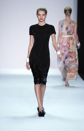 Isaac Mizrahi: One of my favorite pieces is this simple chic, formfitting black sequin dress with stone work that creases in size as it approaches the hem.
