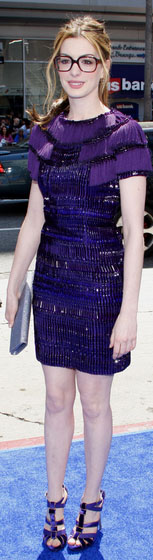 "Anne Hathaway, wearing Gucci, on the blue carpet for the premier of ""Rio"""