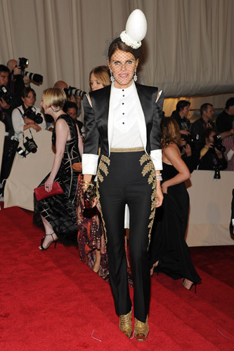 Anna Della Russo wearing Alexander McQueen Black duchesse satin tailcoat, white shirt and gold fern embroidered trousers (SS11) Gold snakeskin hobnail boots (SS11)