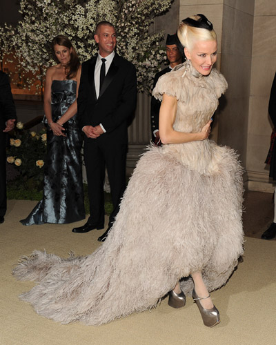 Daphne Guinness wearing Alexander McQueen Lilac feather dress with exaggerated hip (SS11)