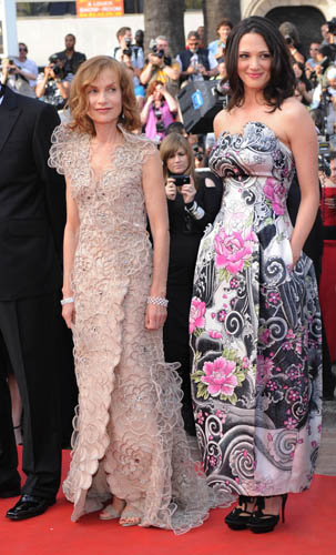 Isabelle Huppert, French actress and President of Jury, in Gioergio Armani PrivA© champagne colour plunging V-neck double-breasted robe-manteau, with all-over silk organza and rhinestone floral embroidery. Asia Argento, member of the Jury, in Giorgio Armani PrivA© silk pagoda style dress with a Coromandel inspired floral print and inlaid motifs, and Swarovski crystals and feature on the top.