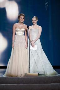 Miley Cyrus alongside Amanda Seyfried in Armani Prive