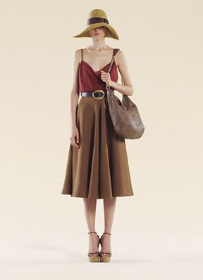 Gucci- Graceful and feminine, our fluid caramel linen canvas flared skirt is natural luxe at its best. Pair with wedge sandals and a whisper-light satin tank for retro-tinged sophistication.